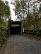 Entry into rainforest via tunnel, where you can drop your bags and coats into lockers